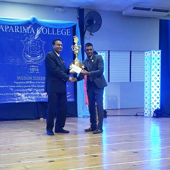 varun-receiving-the-trophy-for-best-all-round-student-from-vice-principal-of-naps-dev-gosine